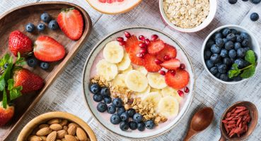 Smoothie bowl with banana, strawberry, blueberry, granola and pomegranate